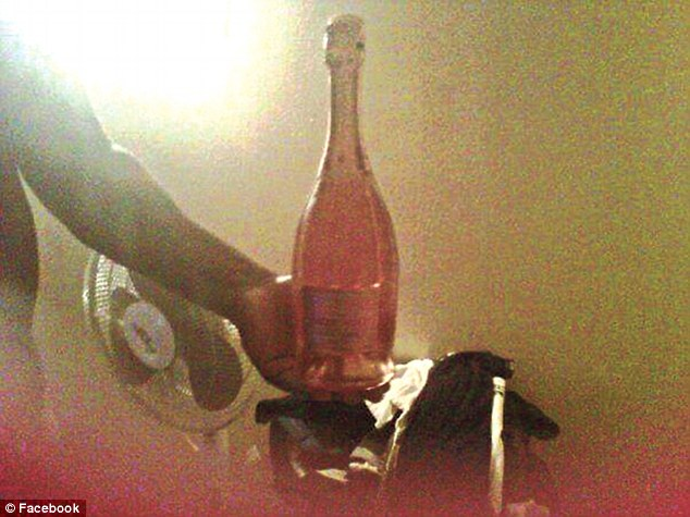 Callous: This image of an apparently naked man holding a bottle of pink champagne was posted on Dalisha Adams' Facebook page hours after she abandoned her two daughters in Brooklyn