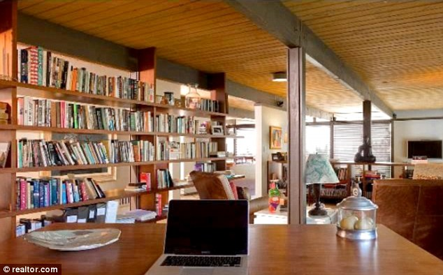 Book worm: The den has plenty of shelving for a library of books