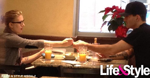Intimate snapshot: Scarlett Johansson and her boyfriend Nate Naylor sharea romantic breakfast at Madison diner on Saturday