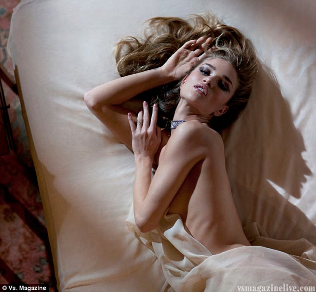 In bed with Rosie: Miss Huntington-Whiteley strips off and slips between the sheets for a new 'intimate' photo shoot for international fashion magazine Vs.