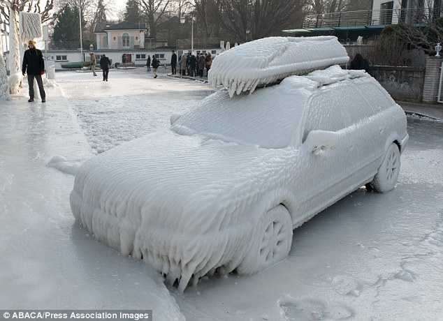 Going nowhere: Parked on the frozen waterside promenade at Lake Geneva in Versoix, Switzerland, this car looks like it has been sprayed from top to bottom with thick ice