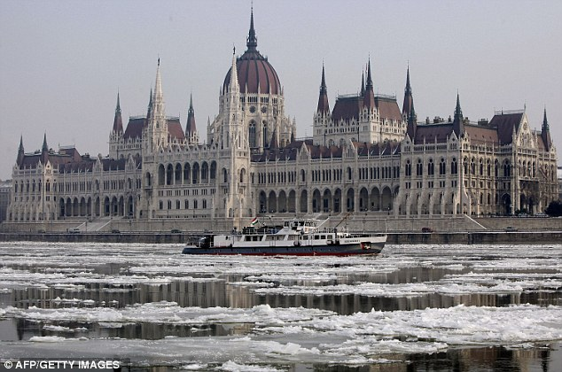 Cold snap: The largest Hungarian icebreaker for rivers, the 40metre-long Szechenyi moves and navigates through the ice-covered waters of the Danube River in front of the parliament building in Budapest