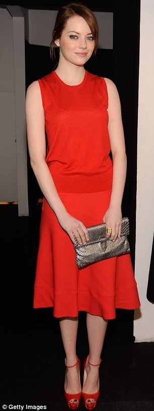 Red and black: Emma and Rooney both went for classic looks but each made sure they coordinated as much as possible