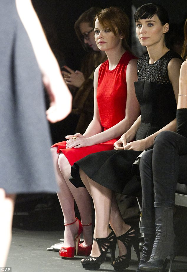 Casting a critical eye: The actresses intently watched as models displayed the Autumn 2012 Calvin Klein collection