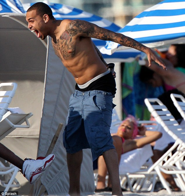 Rage face? Not so much. Chris Brown seemed to be having a blast on Miami Beach today