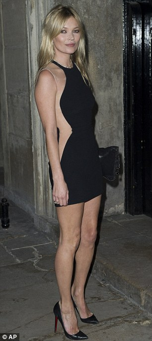 Peekaboo: Kate Moss wore a black mini with see-through mesh side panels to the glittering dinner and presentation