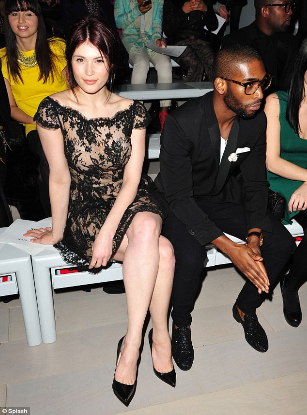 Back to black: As Gemma struck a pose for the camera, Tinoe looked away uninterested in speaking to the actress