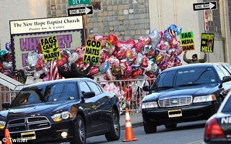 Protest: But this picture of the Westboro Baptist Church picketing Whitney Houston's funeral is apparently a fake