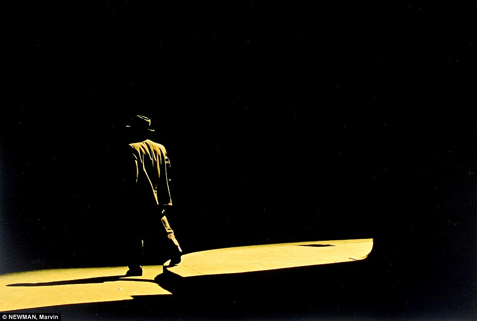 Film noir: A 1956 photo captures a man walking mysteriously through the night