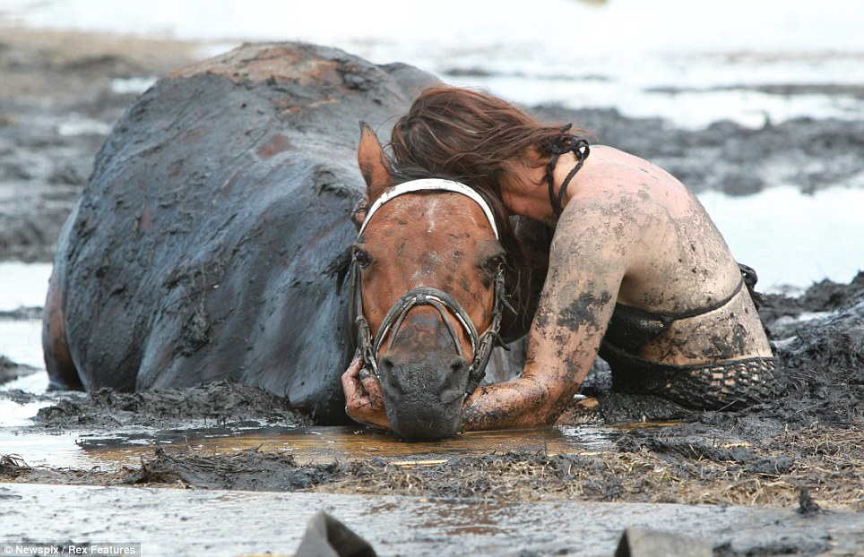 'Like quicksand': Both Miss Graham and her horse were stuck up to their waists in the mud as the tide was closing in
