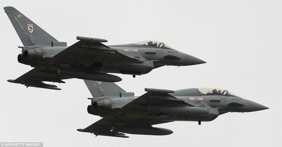Strike force: Two British Royal Air Force Typhoon FGR4 aircraft fly over RAF Waddington near Lincoln, will form part of the force to counter terrorist threats during the Olympics