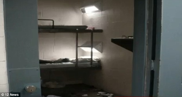 Horror: The aftermath of the cell in the Arizona prison where Anthony Lester slit his throat and wrists