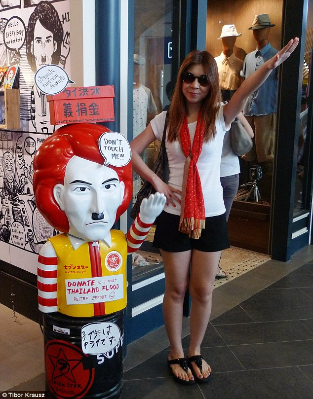 'Nazi chic': A shocking new trend has seen Bangkok flooded with cartoonish images of Hitler - including a popular design in which the dictator is merged with red-haired McDonalds mascot Ronald McDonald