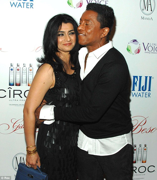 Loved up: Jermaine cuddled up to Halima Rashid, his third wife, at an event last month