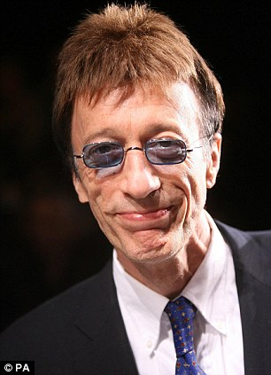 In remission: Bee Gees star Robin Gibb is said to have been told by doctors that he is beating cancer