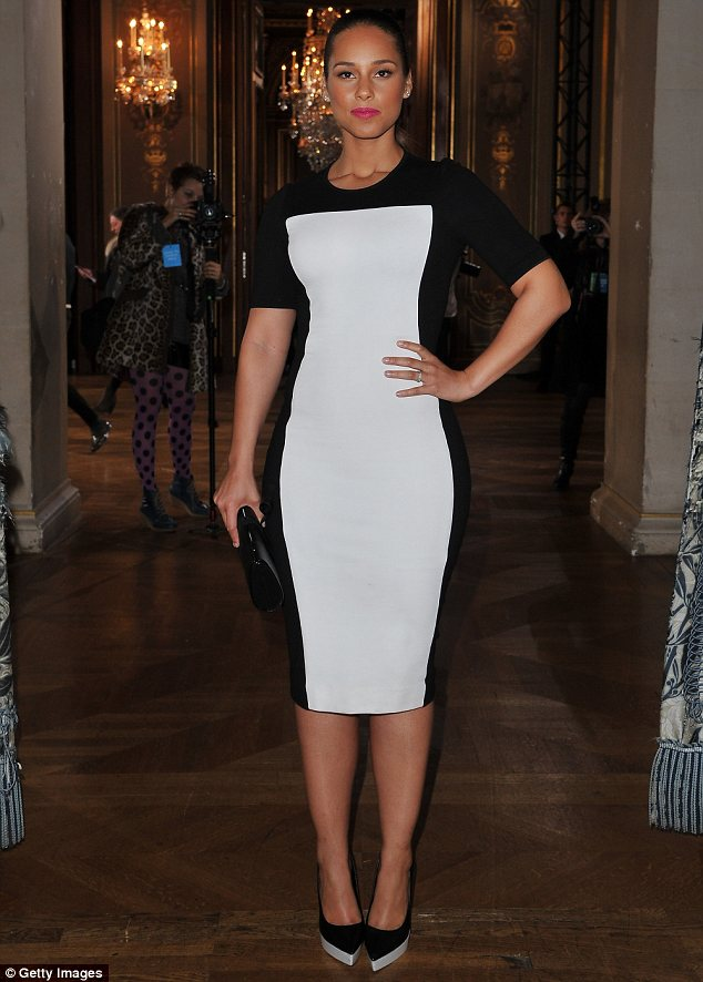 Optical illusion: Alicia Keys highlighted her curves and shaved inches off her midsection in a two tone dress at Stella McCartney