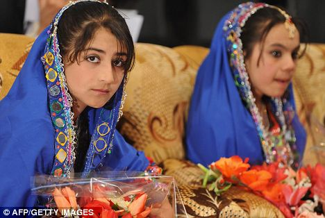 Unveiled: Young Afghan women in traditional clothing participate in a teachers graduation ceremony in March last year