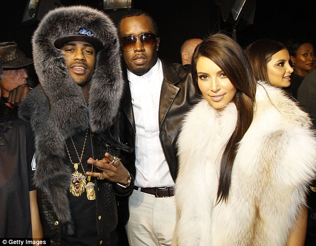 Sean 'Diddy' Combs and Kim Kardashian joined a fur-draped front row - though Liz says reality TV star Kim's presence only served to make the collection seem yet more trashy