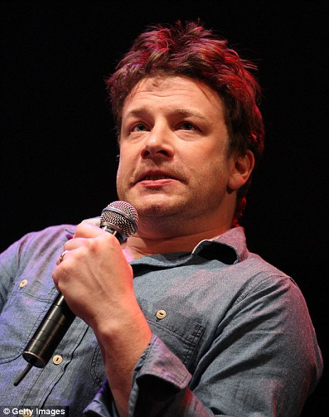 Bristling: Jamie Oliver hit out at a female journalist during an Q&A about responsible eating in Melbourne on Tuesday