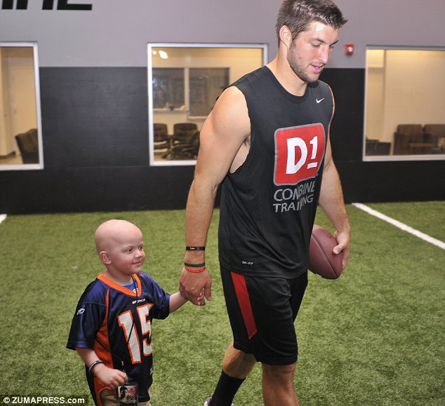 Tim Tebow with 4-year-old leukemia patient Preston Winslow