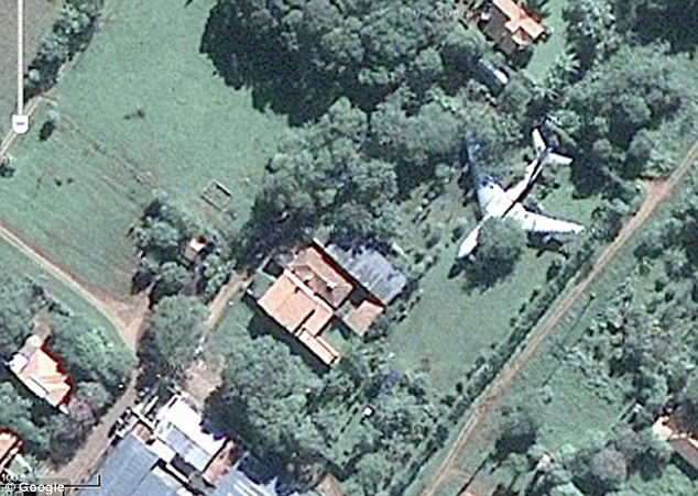This appears to be a real aeroplane hidden in someone's garden in Paraguay, South America