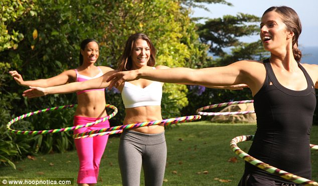 Tail spin: A promotional shot for Hoopnotica's outdoor classes. The company's instructional DVD's helped Mrs Moore lose the 143lbs