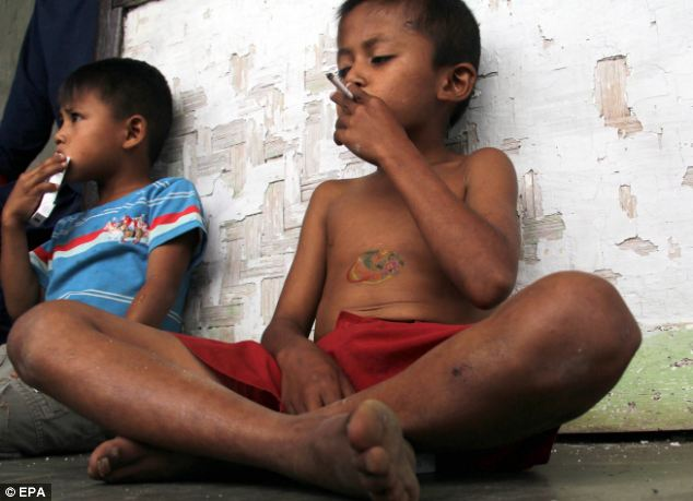 Concerning: Aldi Ilham, from Sukabumi, Indonesia, has smoked since he was four-years-old and gets through a pack of 20 cigarettes in just one day