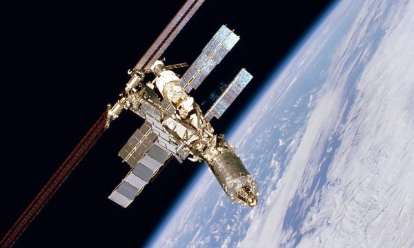 Space station crew shelter in escape pods after after near ...