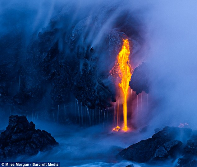 When elements collide: This beautifully atmospheric shot shows a lava flow meeting the sea off Big Island
