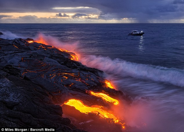 Hot shot: Photographer Miles Morgan has to get dangerously close to the lava flows of the Kilauea volcano in Hawaii to get incredible pictures like this