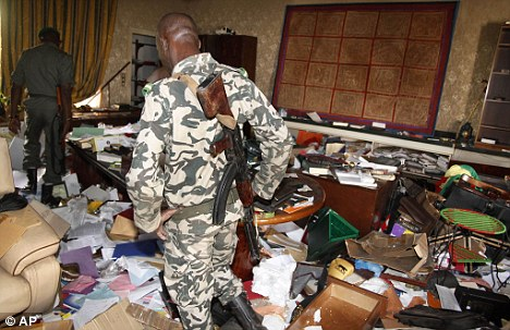 Soldiers walk through the looted presidential palace days after mutinous soldiers claimed power in a coup, in Bamako