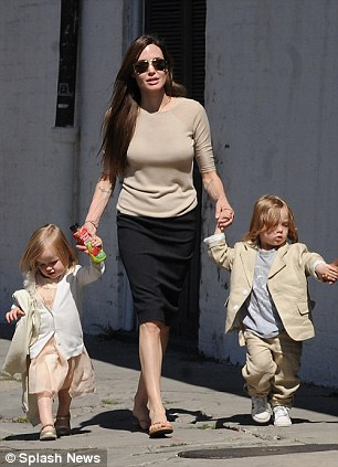 Angelina Jolie and Brad Pitt with their children in New Orleans... Vivienne Jolie-Pitt, Knox Jolie-Pitt