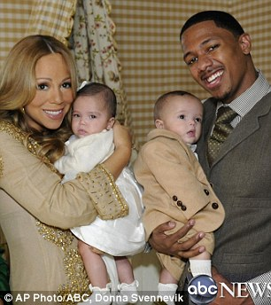Barbara Walter, left, poses with singer Mariah Carey and her husband Nick Cannon as they hold their six-month-old twins, Moroccan and Monroe