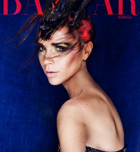 Cover girl: The striking shoot sees Beckham becoming a redhead and wearing yellow eyeshadow - a far cry from her usual style