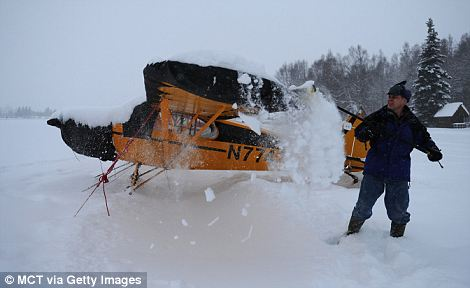 White-out: A spring snowfall has broken the nearly 60-year-old seasonal snow record of Alaska's largest city, Anchorage
