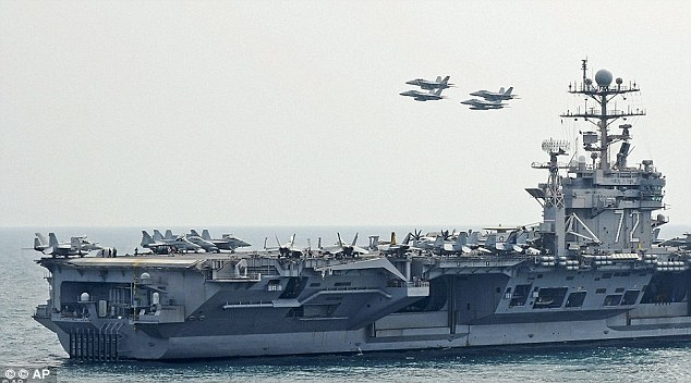 Strait of Hormuz: The Abraham Lincoln aircraft carrier was closely shadowed by Iranian boats and aircraft as it travelled through the strait near Tehran in February