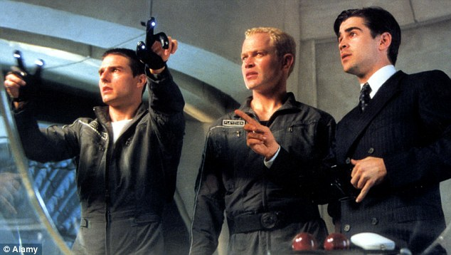 Futuristic: Tom Cruise, left, as John Anderton in the science fiction hit Minority Report, which uses psychic 'precogs' to predict future crimes