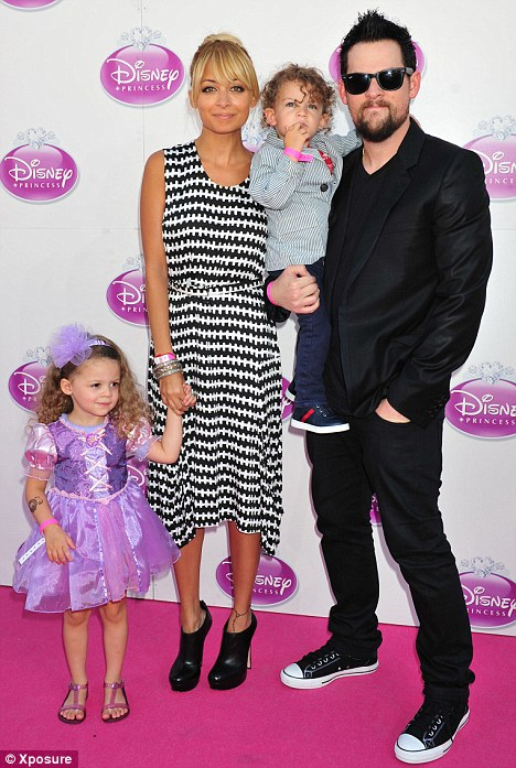 Mr and Mrs: Reluctant bride Nicole Richie with husband Joel Madden and their children Harlow and Sparrow in October