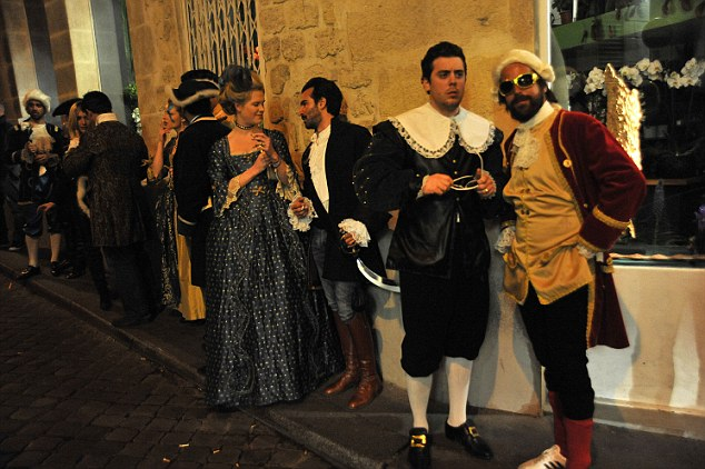 (Back in) time line: Guests at the fancy dress party wait outside the venue in their impressive outfits