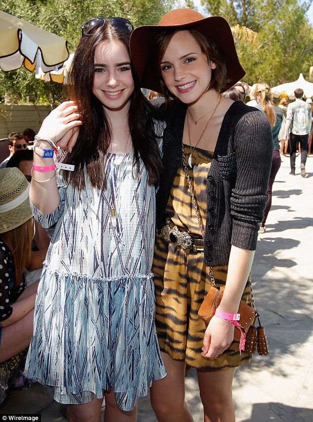 Hollywood's hottest: Emma puts an arm around Lily Collins as they pose with neon wristbands