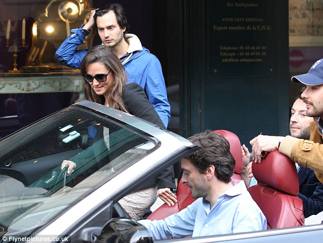 Good time: The 27-year-old sister to the Duchess of Cambridge can be seen getting out of the car to meet a male friend