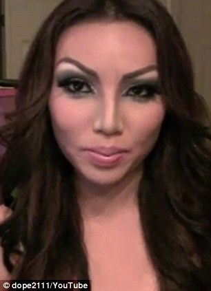 Strike a pose: Promise mimics Kim Kardashian with heavy eye make-up, careful face contouring and a wavy brunette wig