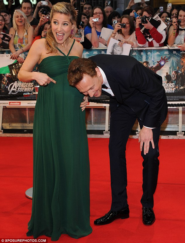 Welcoming their baby: Elsa joked around on the red carpet as she gleefully showed off her bump to Chjris' co-star Tom Hiddleston