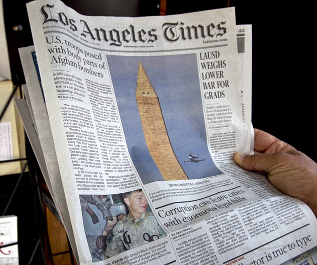 tBig news: The front page of the LA Times newspaper showing U.S. troops posing with Afghan remains from Wednesday, April 18, 2012