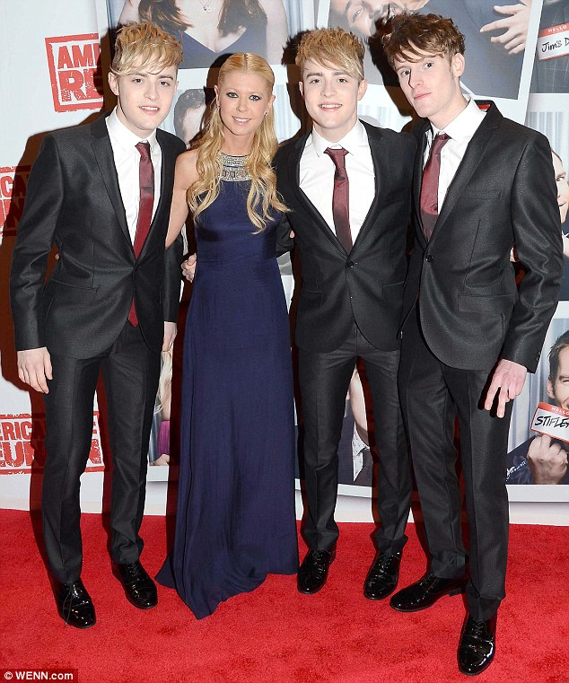 Family affair: Jedward's older brother Kevin accompanied the twins on the red carpet at the Irish premiere of American Reunion in Dublin last night