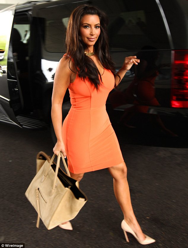 Leggy lady: Kim donned a tight and bright dress to promote The Kardashian Collection at Sears