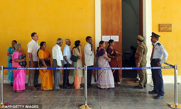 Around the word: Indian-French citizens stand in line at a polling station in Pondicherry, south-east India
