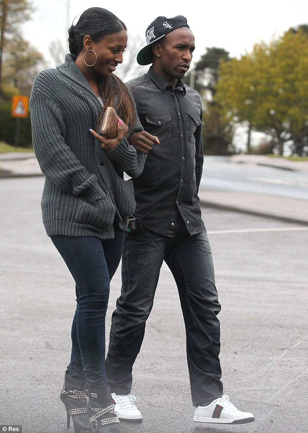 Confirmation: Alexandra Burke and Jermain Defoe confirmed their romance as they were finally pictured together yesterday arm-in-arm, out in Hertfordshire