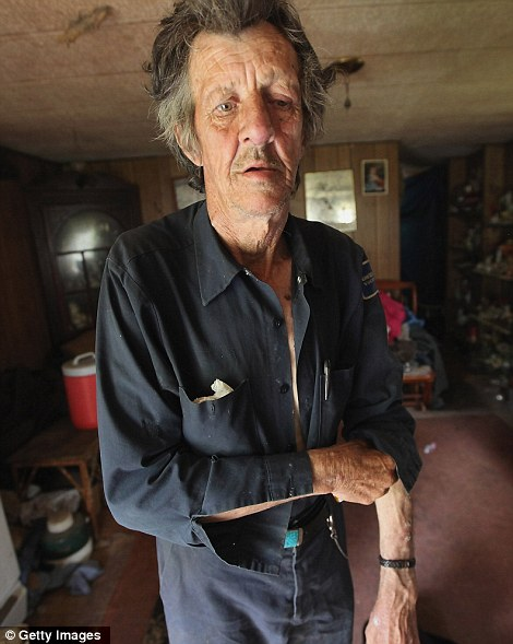 Former chimney sweeper Mose Noble stands in his trailer, that lacks electricity or running water