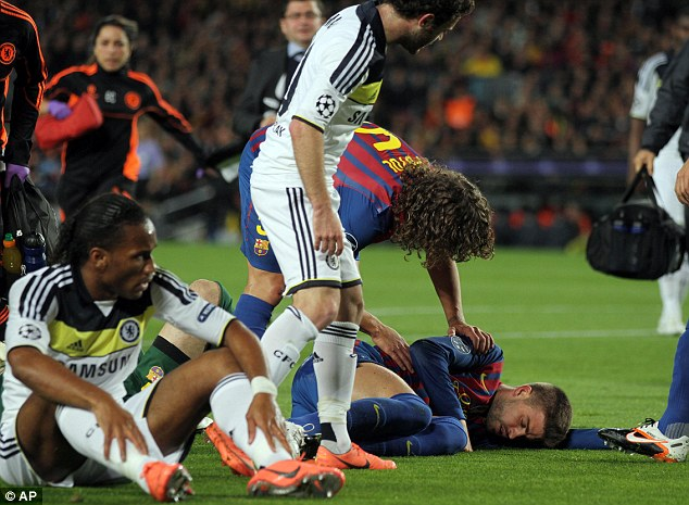 Taking a tumble: Valdes, Drogba and Pique collide, leaving the Barca defender out for the count